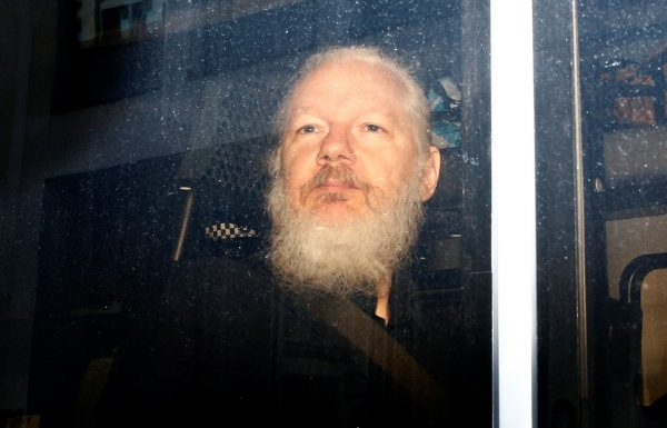 WikiLeaks founder Julian Assange is seen in a police van, after he was arrested by British police, in London