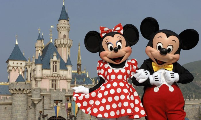 Mickey and Minnie Mouse are seen in front of the Sleeping Beauty Castle at the new Disneyland Park in Hong Kong. (Mark Ashman/Disney via Getty Images)