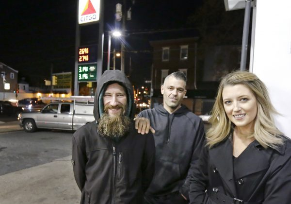 (L-R): Johnny Bobbitt, Kate McClure's boyfriend Mark D'Amico, and Kate McClure pose at a Citgo station in Philadelphia. (Elizabeth Robertson/The Philadelphia Inquirer via AP)