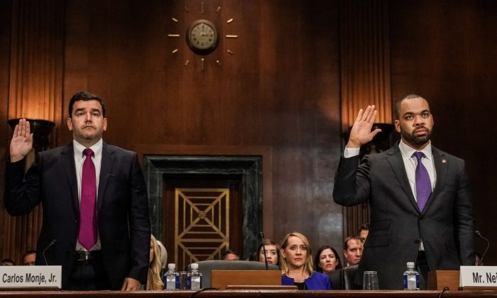 """Carlos Monje, Jr., Twitter director of Public Policy and Philanthropy for U.S. & Canada and Facebook policy director Neil Potts sworn in before testifying at Senate Judiciary Constitution Subcommittee hearing titled """"Stifling Free Speech: Technological Censorship and the Public Discourse."""" on Capitol Hill in Washington on April 10, 2019. (Jeenah Moon/Reuters)"""