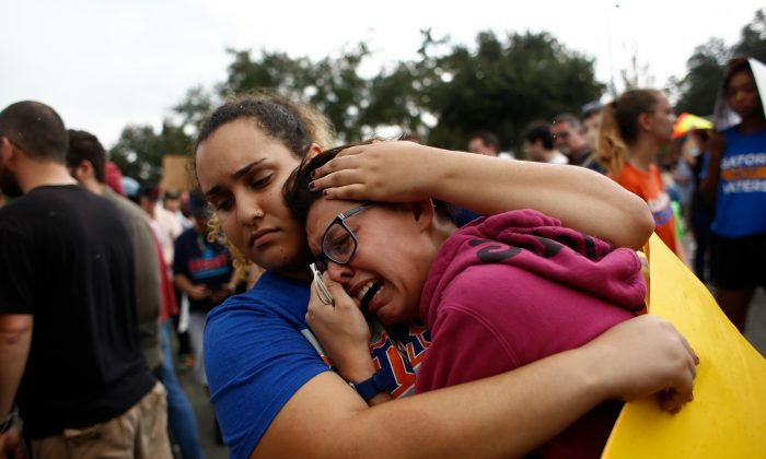 A woman cries and is comforted by a demonstrator after she was refused entry into a planned speech by Richard Spencer, a white nationalist who popularized the term 'alt-right', at the University of Florida campus on October 19, 2017 in Gainesville, Florida. Brian Blanco/Getty Images