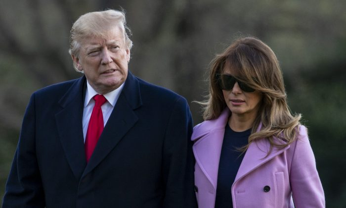 President Donald Trump and First Lady Melania Trump walk off Marine One on the South Lawn of the White House, on March 31, 2019 in Washington, D.C. (Tasos Katopodis/Pool/Getty Images)