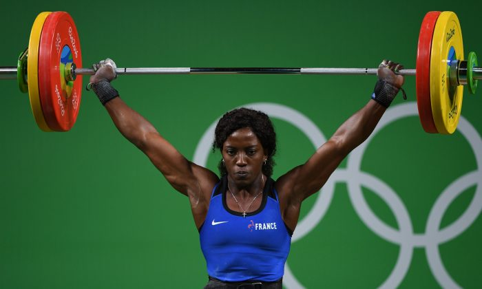 France's Gaelle Verlaine Nayo Ketchanke competes during the women's weightlifting 75 kg event during the Rio 2016 Olympics Games in Rio de Janeiro on Aug. 12, 2016. (Goh Chai Hin/AFP/Getty Images)