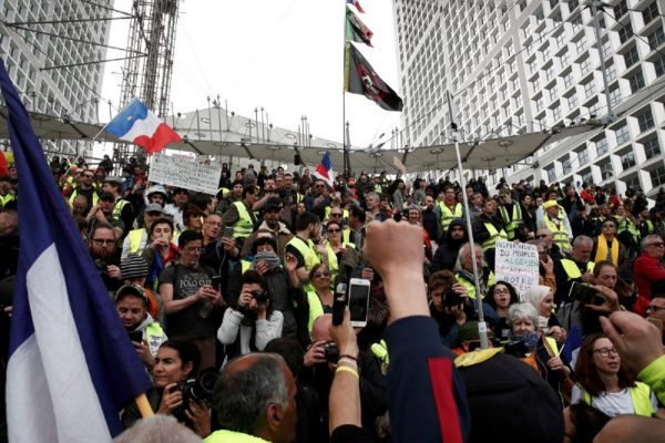 Protesters wearing yellow vests attend a demonstration