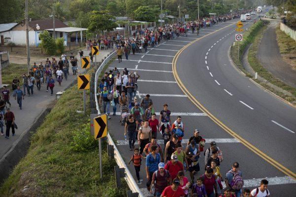 Migrants break border gate 1