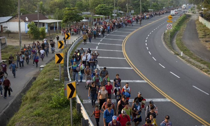 Central American migrants, part of the caravan hoping to reach the U.S. border, walk on the shoulder of a road in Frontera Hidalgo, Mexico, on April 12, 2019. (Isabel Mateos/Photo via AP)