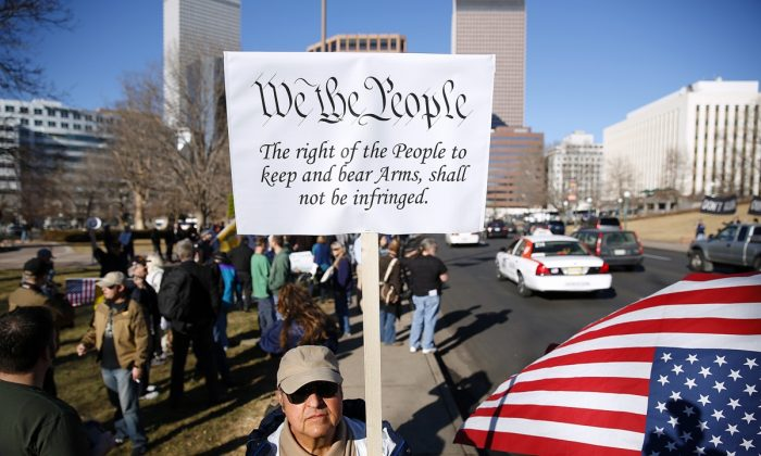 Second Amendment supporters gathered across the street from the Colorado State Capital to voice their support for gun ownership in Denver, Colo. on Jan. 9, 2013. (Marc Piscotty/Getty Images)