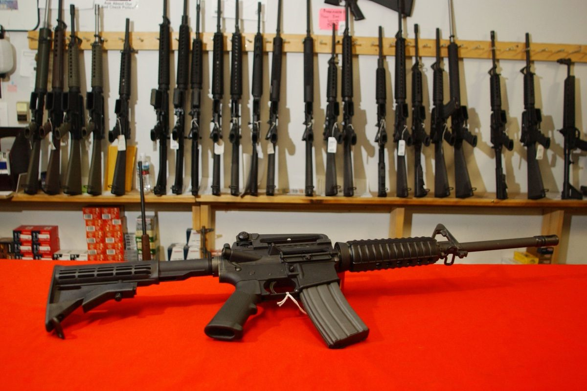 Biden would ban assault rifles, but not force owners to sell them