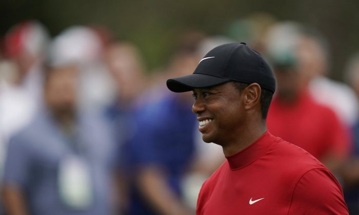 Tiger Woods reacts as he wins the Masters golf tournament. (AP Photo/David J. Phillip)