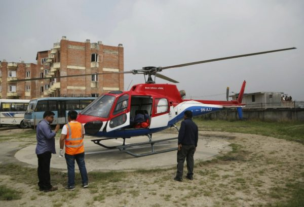 hospital officials stand near helicopter