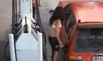 Watch: Woman Gets Thrown Into the Air While Trying to Steal Gas