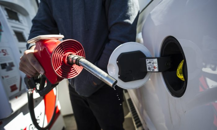 A man fills up his truck with gas in Toronto, on April 1, 2019. The Ontario Court of Appeal will sort out a federal-provincial legal battle over carbon pricing starting April 15. (The Canadian Press/Christopher Katsarov)