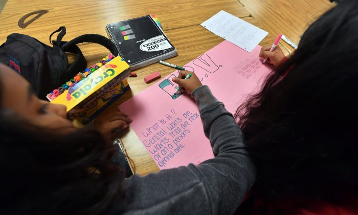 Ninth graders work on projects in the classroom of Health Education teacher Leticia Jenkins at James Monroe High School in North Hills, California on May 18, 2018. (Frederic J. Brown/AFP/Getty Images)