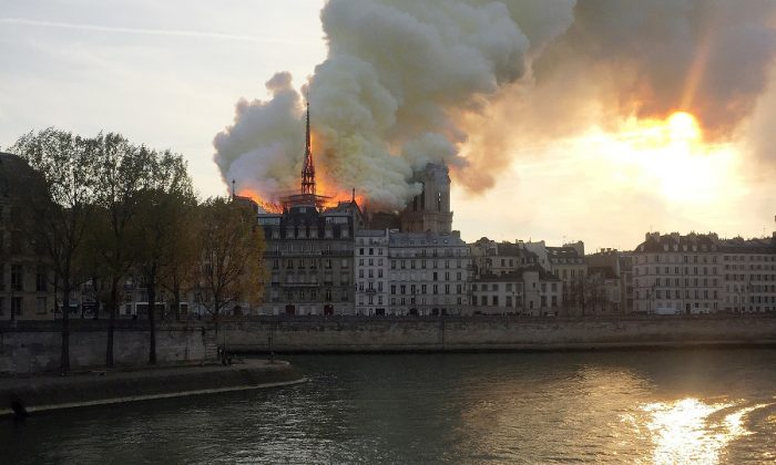 Smoke billows from the Notre Dame Cathedral after a fire broke out, in Paris, France, on April 15, 2019. (Julie Carriat/Reuters)
