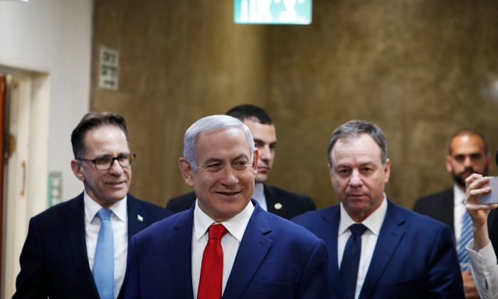 Israeli Prime Minister Benjamin Netanyahu (C) arrives for the weekly cabinet meeting in Jerusalem on April 14, 2019. RONEN ZVULUN/AFP/Getty Images