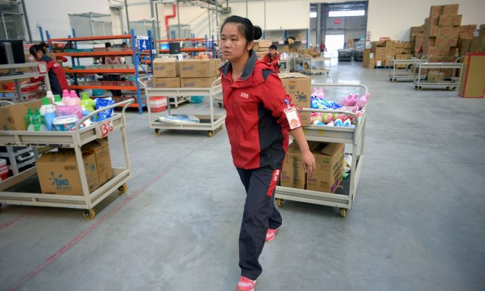 A worker of online marketplace JD.com pushing a trolley at the company's warehouse in Langfang, Hebei province on November 3, 2015. (WANG ZHAO/AFP/Getty Images)