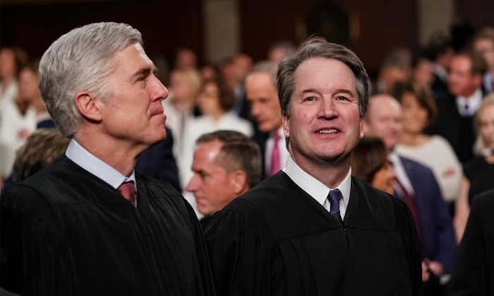 Supreme Court Justices Neil Gorsuch and Brett Kavanaugh attend the State of the Union address in the chamber of the U.S. House of Representatives at the U.S. Capitol Building in Washington on Feb. 5, 2019.(Doug Mills-Pool/Getty Images)