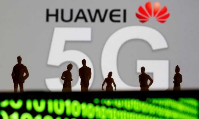 Small toy figures are seen in front of a displayed Huawei and 5G network logo in this illustration picture on March 30, 2019. (Dado Ruvic/Illustration/Reuters)