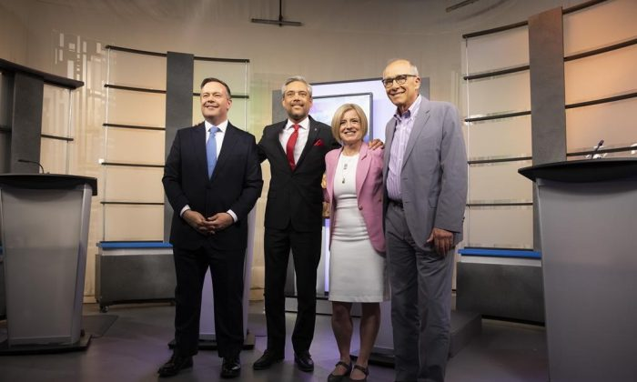 United Conservative Party leader Jason Kenney, left to right, Alberta Liberal Party leader David Khan, Alberta New Democrat Party leader and incumbent premier Rachel Notley and Alberta Party leader Stephen Mandel pose before the start of the 2019 Alberta Leaders Debate in Edmonton on April 4, 2019. (Codie McLachlan/The Canadian Press)