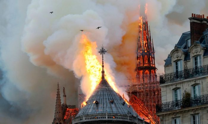 Smoke and flames rise during a fire at the landmark Notre Dame Cathedral in central Paris on April 15, 2019. (Francois Guillot/AFP/Getty Images)