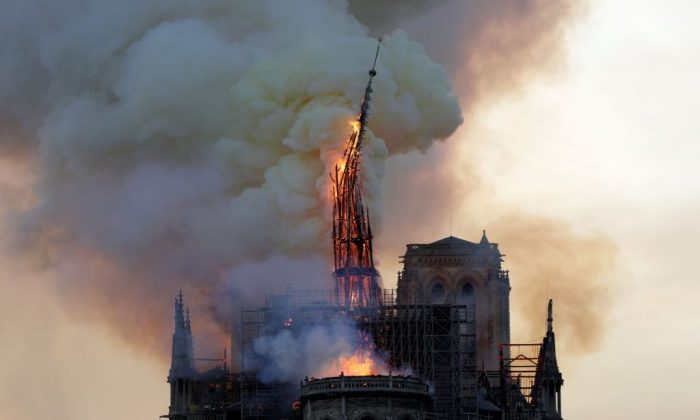 The steeple of the landmark Notre-Dame Cathedral collapses as the cathedral is engulfed in flames in central Paris on April 15, 2019. (Geoffroy Van Der Hasselt/AFP/Getty Images)