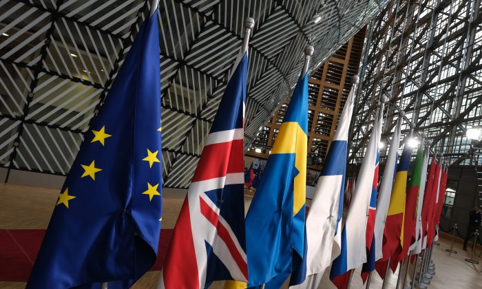 The flags of the European Union stand among others in the Europa building of the European Council in this file photo. (Sean Gallup/Getty Images)