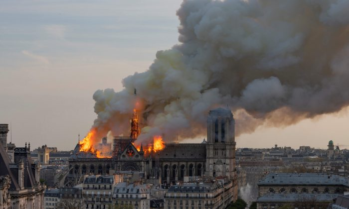 Smoke billows as flames burn through the roof of the Notre-Dame Cathedral in Paris, on April 15, 2019. (Fabien Barrau/AFP/Getty Images)