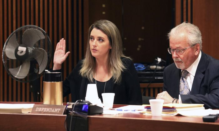 Kate McClure, 29, charged with theft by deception in the $400K GoFundMe scam, with her lawyer Jim Gerrow Jr., pleads guilty before State Superior Court Judge Christopher Garrenger in Burlington County Courthouse, Mt. Holly, N.J., on April 15, 2019. (David Swanson/The Philadelphia Inquirer via AP)