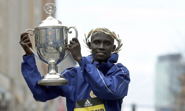 Lawrence Cherono, of Kenya, holds the trophy after winning the 123rd Boston Marathon, in Boston on April 15, 2019. (Winslow Townson/AP Photo)