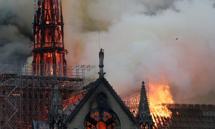 Smoke billows near scaffolding as fire engulfs the spire of Notre Dame Cathedral in Paris, France, on April 15, 2019. (Benoit Tessier/Reuters)