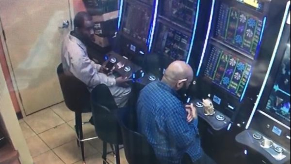 suspect lifts panel on machine