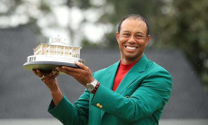American Golf Champion Tiger Woods holds the Masters Trophy at Augusta National Golf Club in Augusta, Ga., on April 14, 2019. (Andrew Redington/Getty Images)