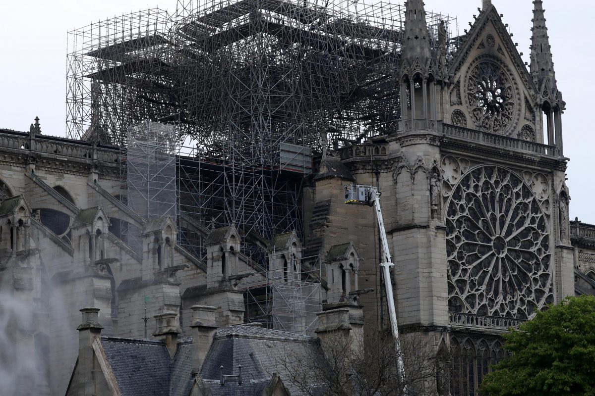 Firefighters work at Notre-Dame Cathedral in Paris