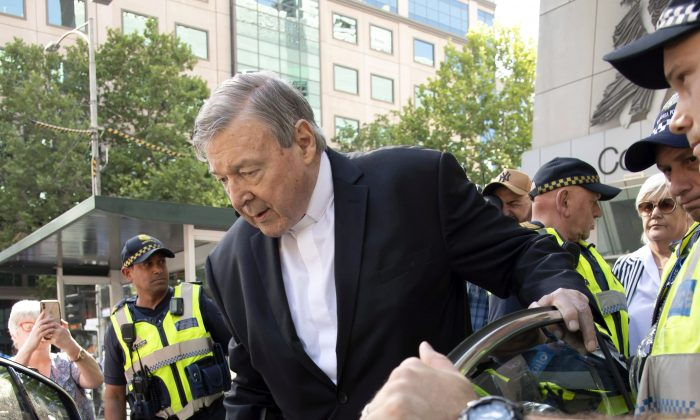 Cardinal George Pell leaves the County Court in Melbourne, Australia, on Dec. 11, 2018. Pell was sentenced on March 13 to six years in prison for molesting two choirboys more than 20 years ago. (AP Photo/Andy Brownbill)