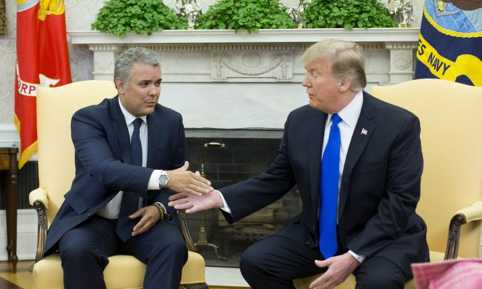 U.S. President Donald Trump meets with Colombian President Ivan Duque at the Oval Office in the White House on Feb. 13, 2019. (Michael Reynolds-Pool/Getty Images)