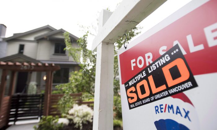 A real estate sign is pictured in Vancouver on June 12, 2018. Vancouver's housing market has been hit particularly hard by the federal mortgage stress test. (The Canadian Press/Jonathan Hayward)