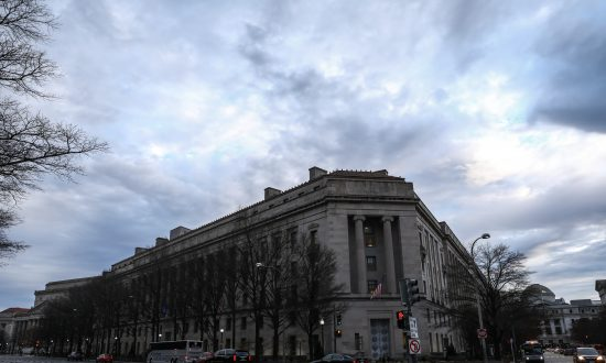 Watchdog Sues Justice Department for FBI Contacts With Democratic Law Firm