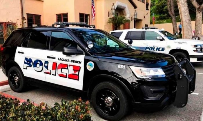 This undated photo provided by the Laguna Beach Police Department shows their newly decorated Police SUV patrol vehicles in Laguna Beach, Calif. (Laguna Beach Police Department via AP)