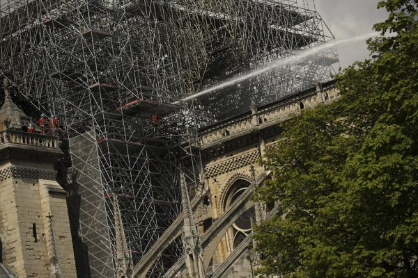 Firefighters work with a hose at the Notre Dame cathedral in Paris
