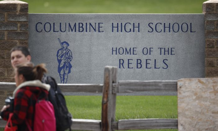Students leave Columbine High School in Littleton, Colo., on April 16, 2019. (David Zalubowski/Photo via AP)