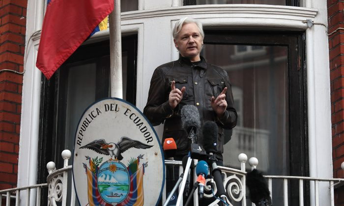 Julian Assange speaks to the media from the balcony of the Embassy of Ecuador in London on May 19, 2017. (Jack Taylor/Getty Images)