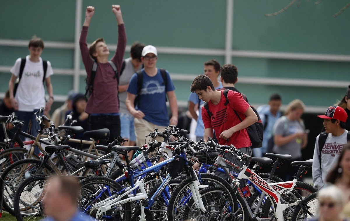 Students leave Columbine High School late in Littleton, Colo.,