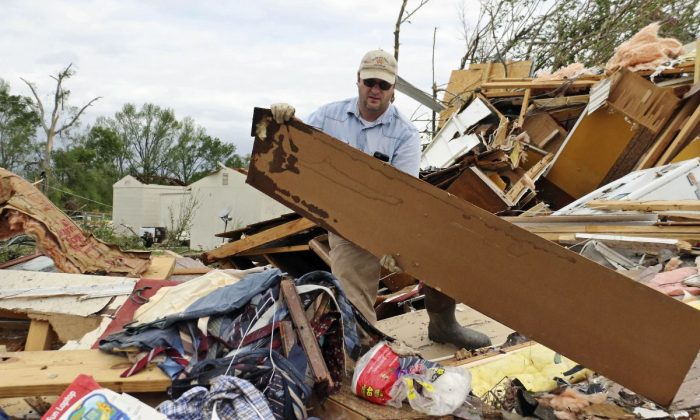 A man clears rubble after the storm at Hamilton, Mississippi, on April 14, 2019. (AP Photo/Jim Lytle)