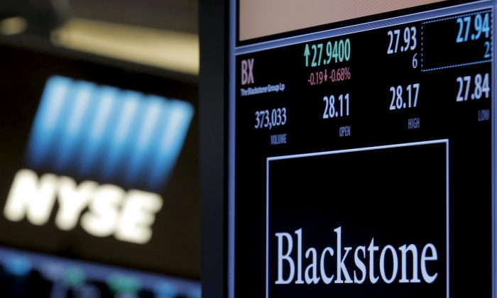 Ticker and trading information for Blackstone Group at the New York Stock Exchange in N.Y. on April 4, 2016. (Brendan McDermid/Reuters)