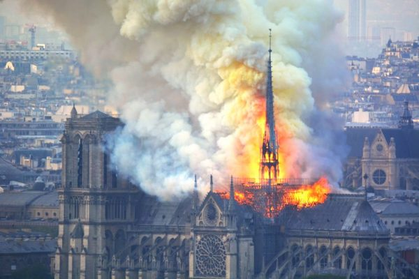 Smoke and flames rise during a fire at the landmark Notre-Dame Cathedra