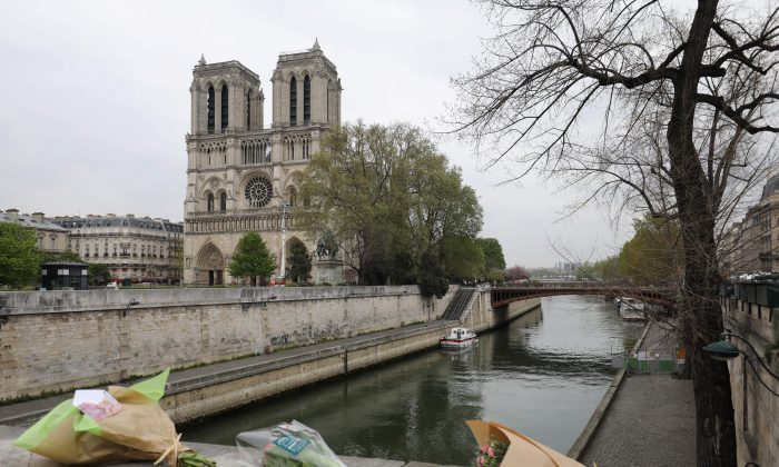 Roses have been laid near Notre-Dame-de Paris Cathedral a day after a fire devastated the cathedral in central Paris on April 16, 2019. (Ludovic Marin/AFP/Getty Images)