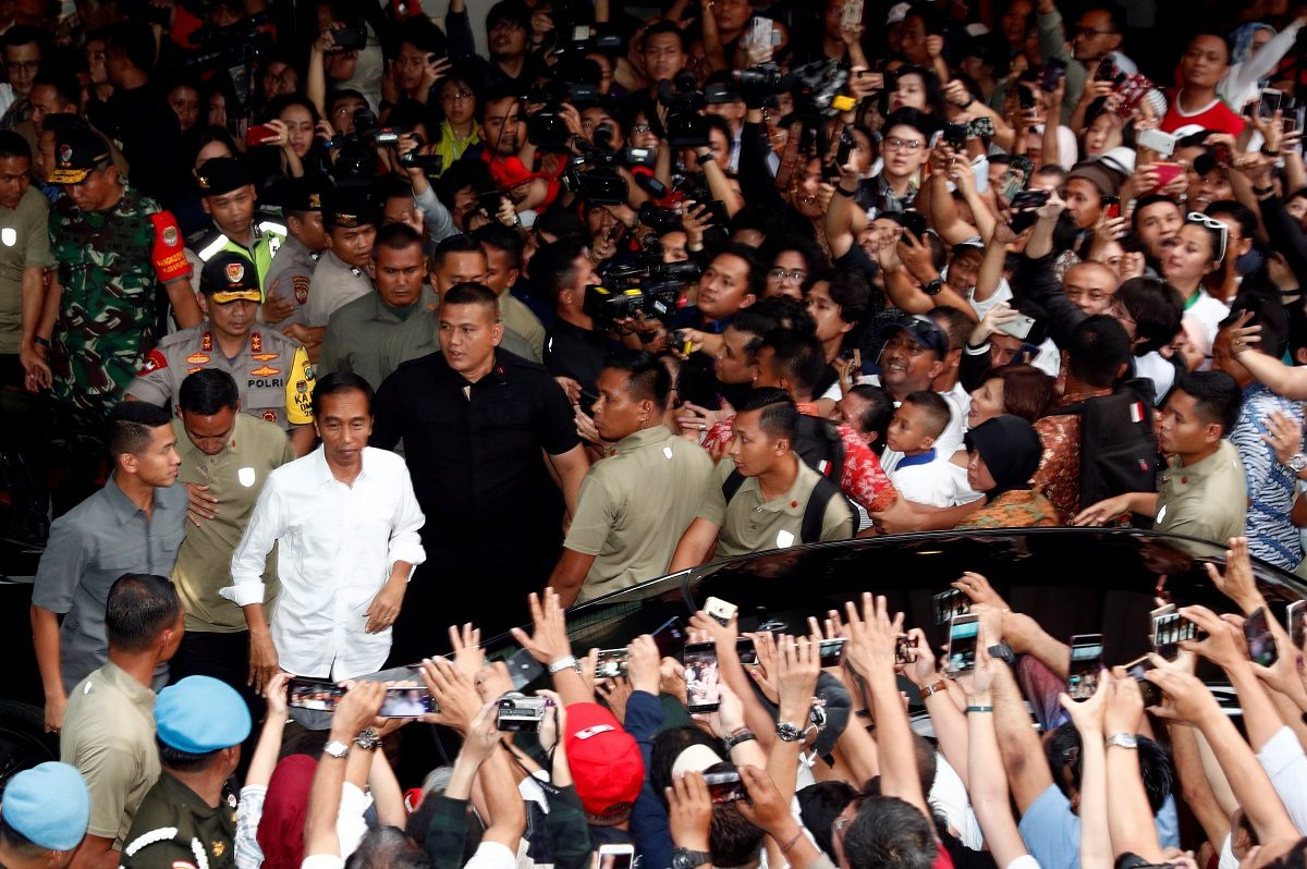 Indonesia's President Joko Widodo reacts after a quick count result