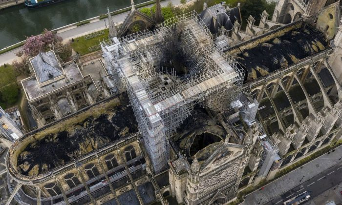 An image made available by Gigarama.ru on April 17, 2019, shows an aerial shot of the fire damage to Notre Dame cathedral in Paris on April 16. (Gigarama.ru via AP)