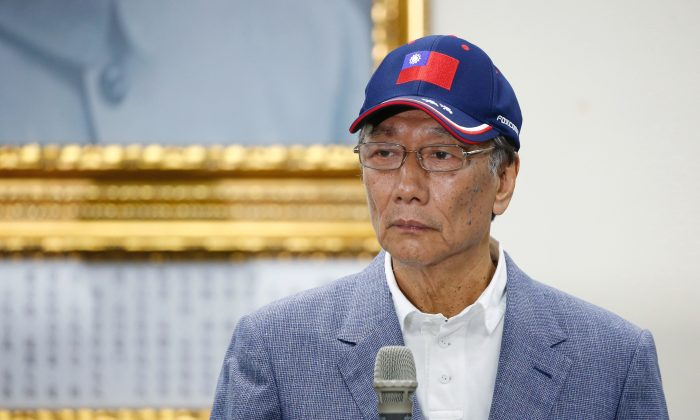 Terry Gou, founder and chairman of Foxconn, looks on during an announcement of seeking the nomination of Taiwan's opposition Kuomintang party to run for the island's presidency, in Taipei on April 17, 2019. (Tyrone Siu/Reuters)