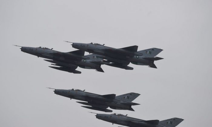 Pakistani fighter jets perform during the Pakistan Day parade in Islamabad on March 23, 2019. (Farooq Naeem/AFP/Getty Images)